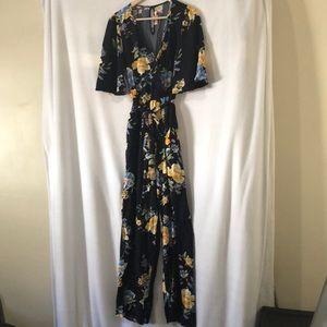 Beautiful woman floral dress jumpsuit